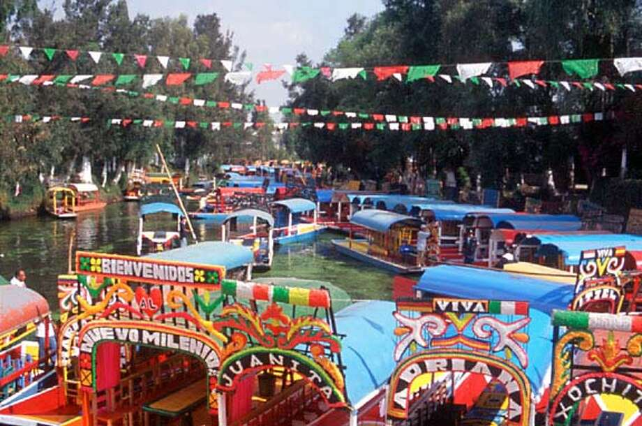 TRAVEL MEXICO CITY -- The floating gardens of Xochimilco, about 15 miles from Mexico City's central Zocalo, is a remnant of the vast system of the Aztec lakes and canals that amazed the Spanish conquistadors nearly five centuries ago. They are now a popular playground for residents and tourists.  Guillermo Aldana/Mexico Tourist Board Ran on: 06-13-2004  The floating gardens of Xochimilco, about 15 miles from Mexico City's central Z�calo, are a remnant of the vast system of Aztec lakes and canals that amazed the Spanish conquistadors nearly five centuries ago. Now they are a popular playground for residents and tourists. Photo: Guillermo Aldana