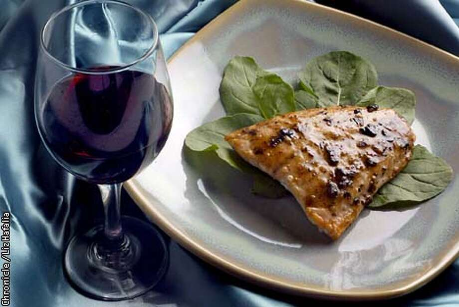 Salmon roasted with black bean sauce. (PHOTOGRAPHED BY LIZ HAFALIA/STYLED BY NOEL AVINCULA/THE SAN FRANCISCO CHRONICLE) Photo: LIZ HAFALIA