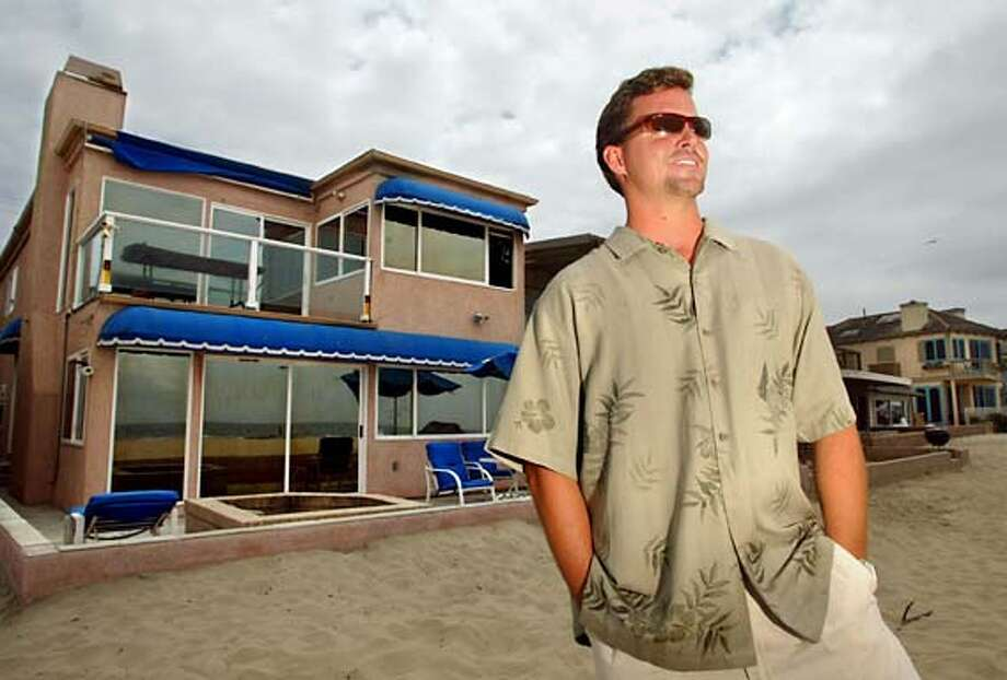 MB--(Newport Beach)--Real Estate Agent Christopher Parr with Strada Properties stood outside Dennis Rodman's home in Newport Beach. Parr listed the house and sold it in two days. Dennis Rodman, the onetime bad boy of the NBA who used to anger his neighbors with loud parties is leaving his beachfront home in Newport Beach in search of a quieter lifestyle. Rodman's home has reportedly been sold for $3.8 million dollars. June 8, 2004 Photo: Mark Boster