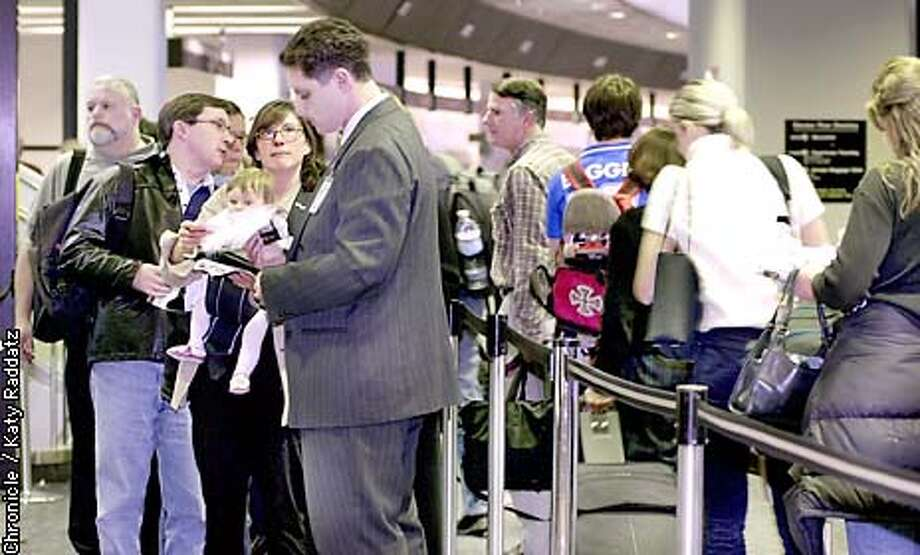PHOTO BY KATY RADDATZ--THE CHRONICLE  Lines of people at security checkpoints at United Airlines at San Francisco International Airport.The man in the grey suit is checking EVERYBODY's ticket. Photo: KATY RADDATZ