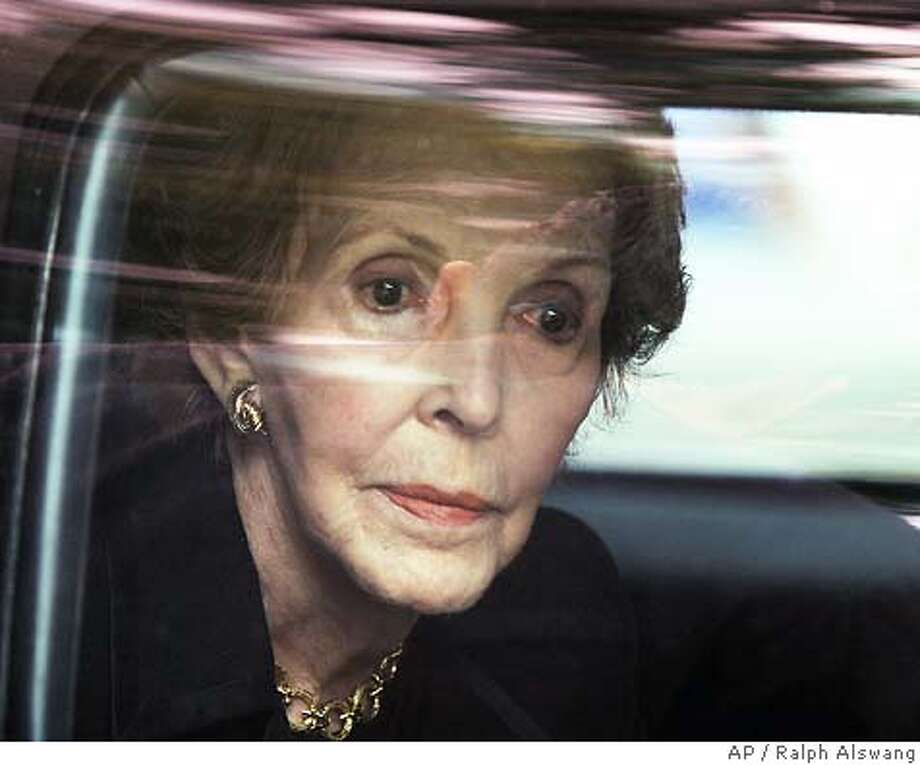 Former first lady Nancy Reagan waits inside a limosine for her husband former President Ronald Reagan's casket to be carried from the U. S. Capitol Friday, June 11, 2004. (AP Photo/ Ralph Alswang, POOL) Photo: RALPH ALSWANG