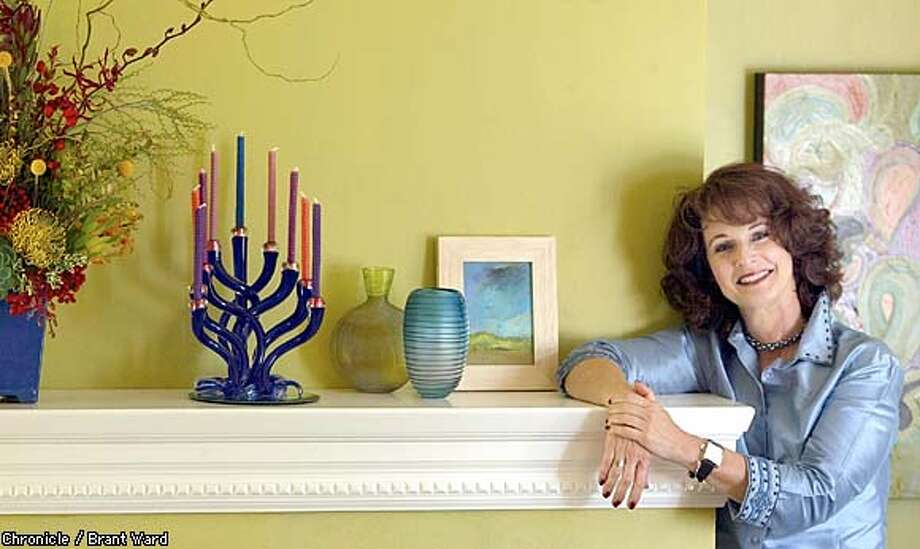 Scene Change: Decorator Rachelle Goodfriend suggests planning ahead for a quick makeover from Thanksgiving to Hanukkah. Chronicle photo by Brant Ward