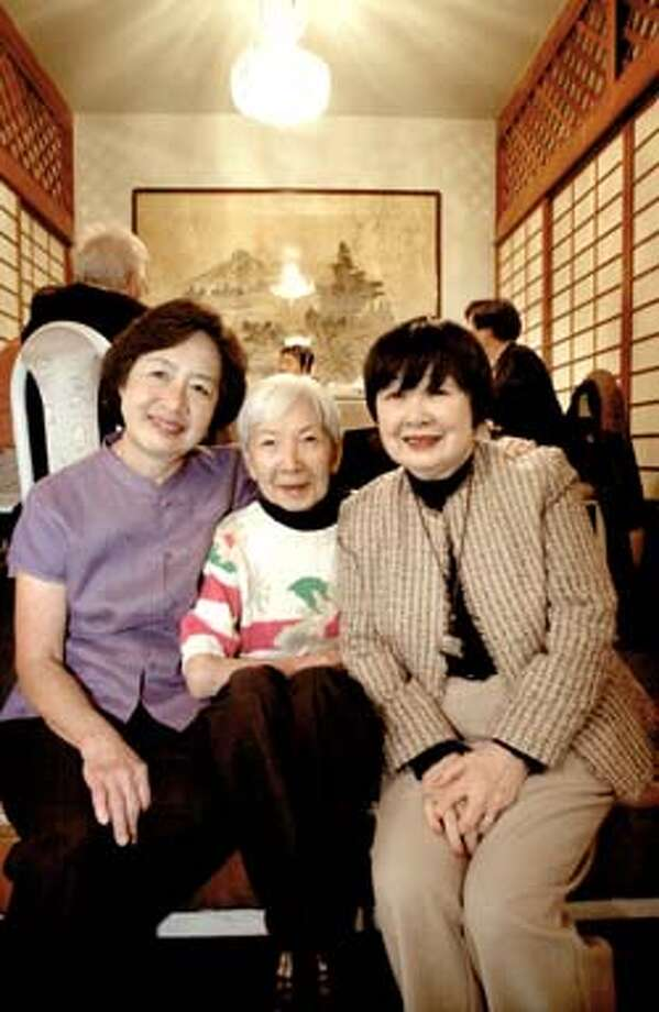 SHOWN: L to R: Rachel Hum, Rosemary Chan, Alice Lowe, while the meeting of the Square in Circle goes on at the table in back of them at Louie's Chinese Restaurant on Washington St. in San Francisco. The Square in Circle, one of the oldest Chinese women's service organizations, is celebrating its 80th anniversary in June. Katy Raddatz / The Chronicle Photo: Katy Raddatz