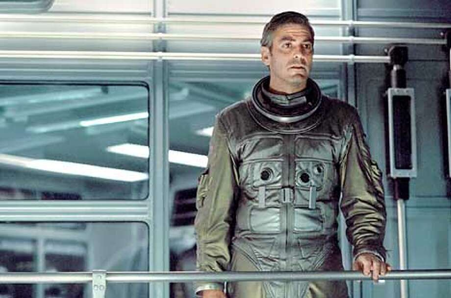 Strange occurrences � and a love he thought he had left behind � await Chris Kelvin (George Clooney) upon his arrival at a distant space station. HANDOUT PHOTO Photo: HANDOUT