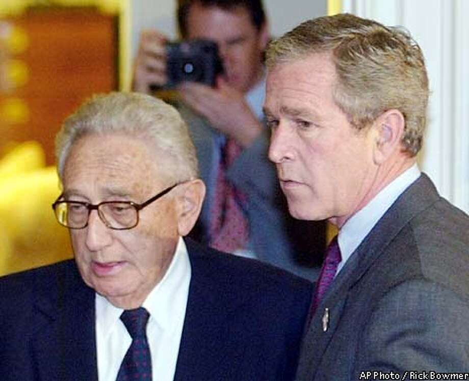 President Bush, right, shows former Secretary of State Henry Kissinger into the Roosevelt Room before the signing of the Intelligence Authorization Act, Wednesday, Nov. 27, 2002, at the White House in Washington. Bush signed legislation creating a new independent commission to investigate the Sept. 11 attacks Wednesday and named Kissinger to lead the panel. (AP Photto /Rick Bowmer) Photo: RICK BOWMER