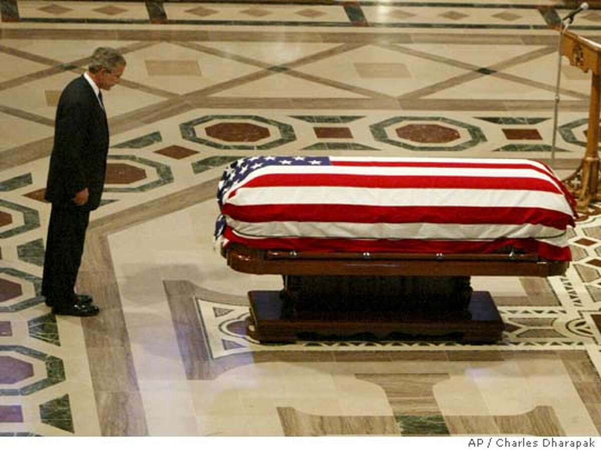 President Bush pauses at the casket of former President after speaking during funeral services at the National Cathedral in Washington Friday, June 10, 2004. (AP Photo/)