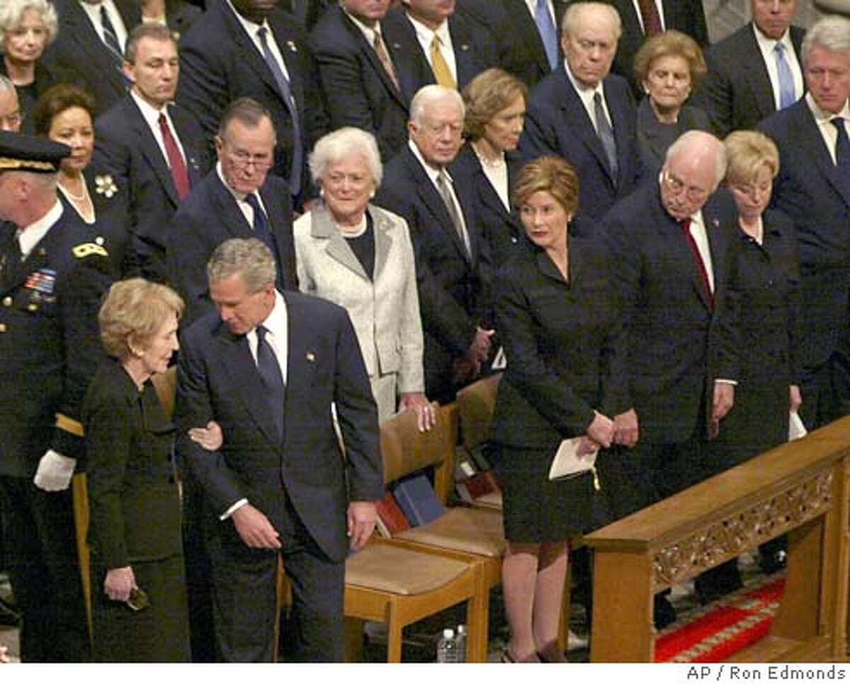 President Bush escorts former first lady Nancy Reagan as she arrives at the National Cathedral in Washington Friday, June 10, 2004 for funeral services for former President . (AP Photo/Ron Edmonds)