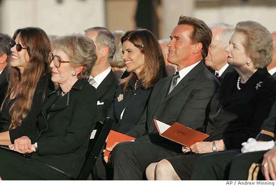 Patti Davis, left, Nancy Reagan, Maria Shriver, Arnold Schwazrenegger, and Margaret Thatcher during the interment ceremony for President Friday, June 11, 2004 at the Presidential Library in Simi Valley, Calif. (AP Photo/Andrew Winning) Photo: ANDREW WINNING