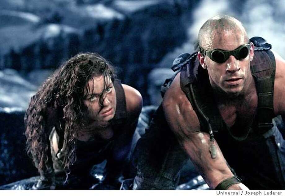 RIDDICK11  Riddick (VIN DIESEL) and Kyra (ALEXA DAVALOS) attempt escape from a subterranean prison in the science fiction action-adventure, The Chronicles of Riddick. Photo: Photo Credit: Joseph Lederer.