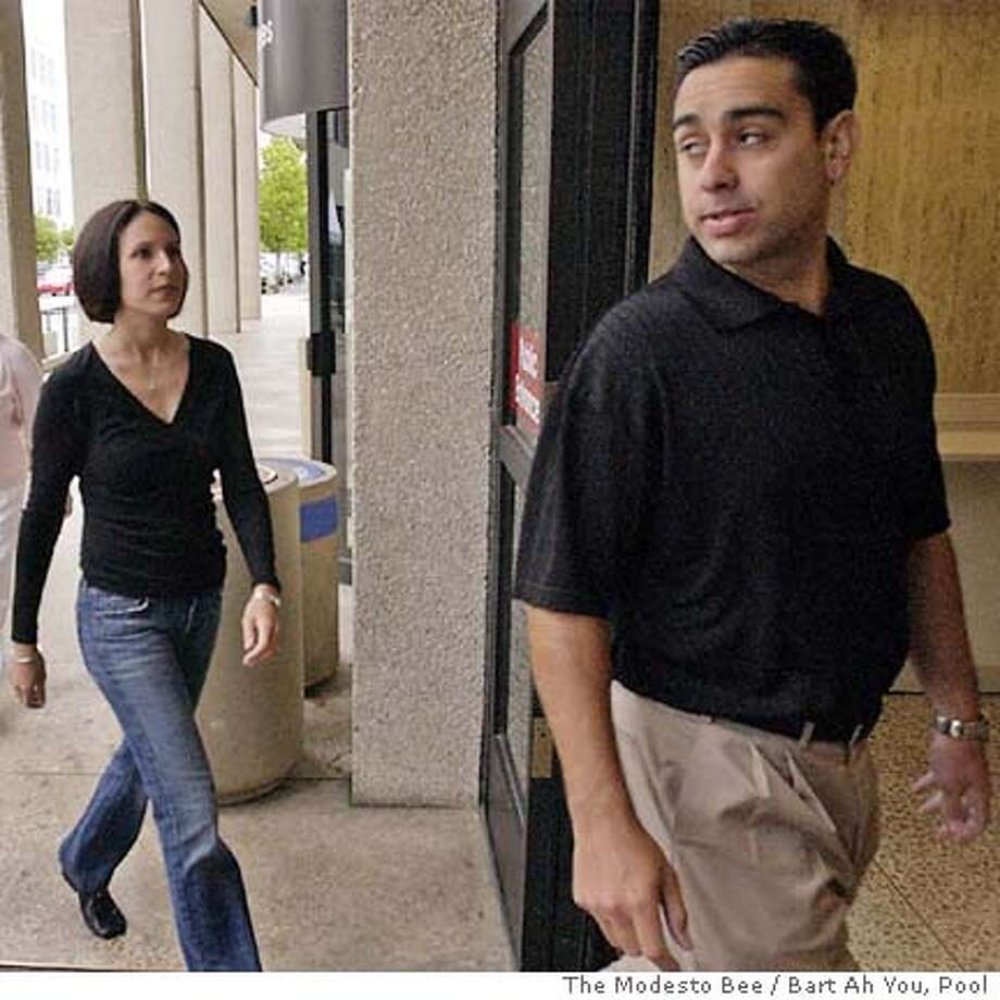 Brent Rocha, right, brother of , followed by his wife, Rose Marie Rocha , enters the San Mateo County Courthouse in Redwood City, Calif., Thursday, June 10, 2004. Scott Peterson, from Modesto, is in on trial for the murder of his wife , 27, and the couple's unborn son. Others are unidentified. (AP Photo/The Modesto Bee, Bart Ah You, Pool) Photo: BART AH YOU