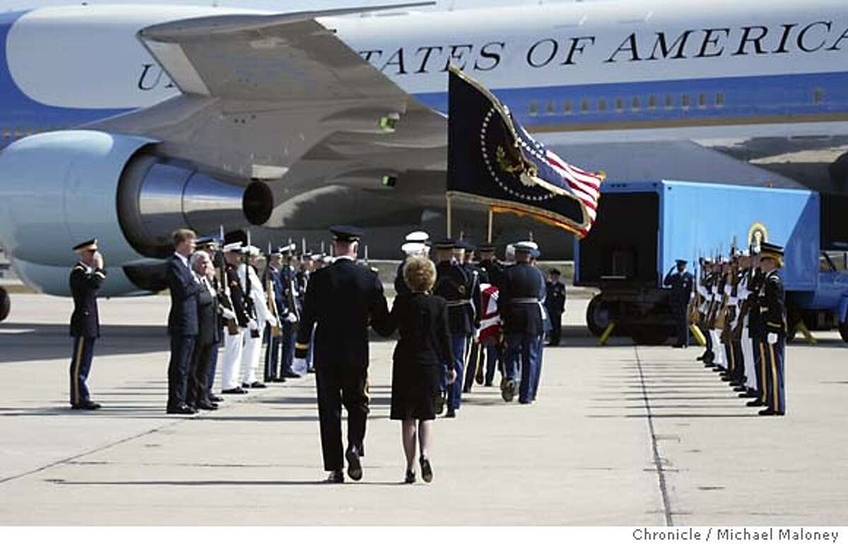 Former First Lady Nancy Reagan and Maj. Gen. Galen B. Jackman, Commanding General, US Army Military District of Washington, Washington, DC. follow the casket as it is placed on the presidential plane. The casket of former President Ronald Reagan along with his family departed Naval Base Ventura County in Point Mugu on a presidential aircraft, enroute to Andrews Air Force Base near Washington DC. After lying in state at the Capitol Rotunda and a national and state funeral ceremonies, the casket will be flown back to the Presidential Library in Simi Valley, CA for burial on Friday. Photo by Michael Maloney / San Francisco Chronicle
