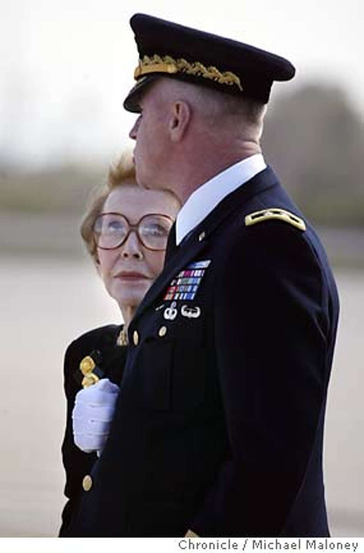 Former First Lady Nancy Reagan and Maj. Gen. Galen B. Jackman, Commanding General, US Army Military District of Washington, Washington, DC. wait as the casket is removed from the hearse. The casket of former President Ronald Reagan along with his family departed Naval Base Ventura County in Point Mugu on a presidential aircraft, enroute to Andrews Air Force Base near Washington DC. After lying in state at the Capitol Rotunda and a national and state funeral ceremonies, the casket will be flown back to the Presidential Library in Simi Valley, CA for burial on Friday. Photo by Michael Maloney / San Francisco Chronicle