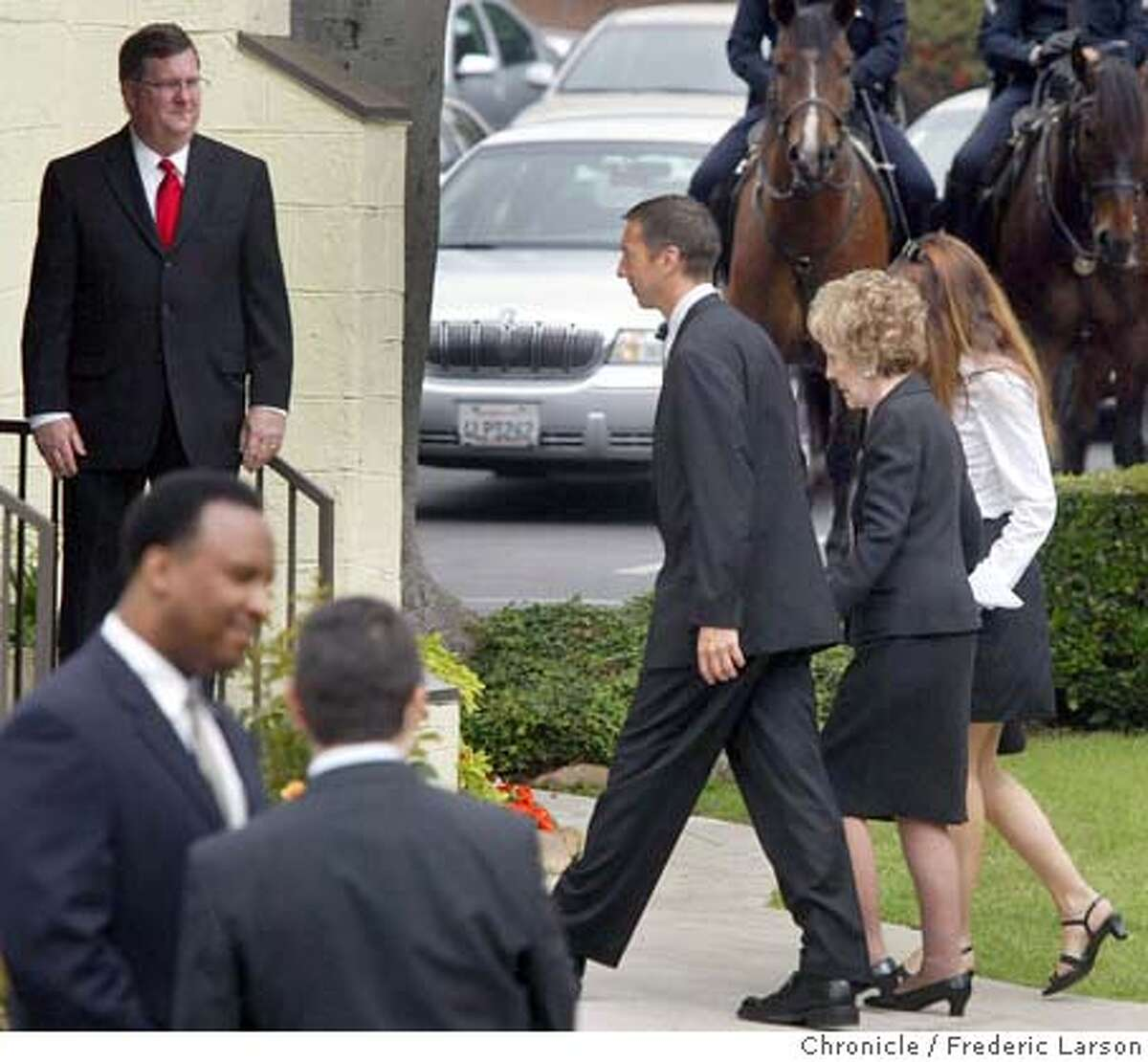 ; Bob Boetticher (far left ) a funeral director for 40 years, was the last person to see the nation's 40th president. Boetticher waits the Reagan family to enter the Gates Kingsley Gate Mortuary where he prepared President Regan for burial. He called the funeral an honor and the pinnacle of his career. 6/7/04 San Francisco Chronicle Frederic Larson