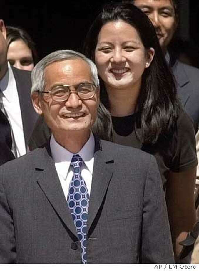 FILE--Dr. leaves federal court in Albuquerque, New Mexico followed by his daughter Alberta Lee in this Sept. 13, 2000, file photo. The FBI wasted four years investigating Lee because it failed to correct misleading information provided by the Energy Department in 1996, according to a report prepared for the government. Lee, a former nuclear scientist at Los Alamos National Laboratory in New Mexico, was held in solitary confinement for nine months and indicted on 59 felony counts alleging he transferred nuclear weapons information to portable computer tapes. (AP Photo/LM Otero, File) Photo: LM OTERO