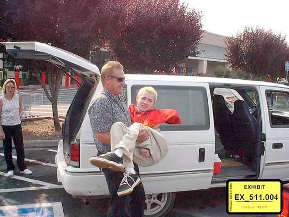 maxfield v. bryco � The photo of Brandon and his dad  � on 6/8/04 in San Francisco. / HO