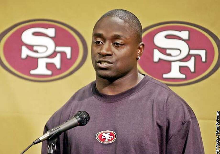 San Francisco 49ers running back Garrison Hearst apologizes during a news conference at the team's headquarters in Santa Clara, Calif., Friday, Nov. 22, 2002, for anti-gay remarks he made. In an interview with the Fresno Bee three weeks ago, Hearst used a slur to describe gays, and said he wouldn't want a gay player as a teammate. (AP Photo/Paul Sakuma) Photo: PAUL SAKUMA