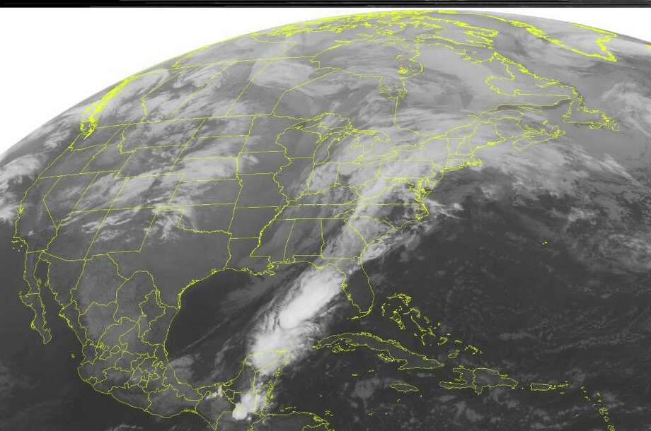 This NOAA satellite image taken Friday, Jan. 27, 2012 at 12:45 a.m. EST shows clouds cover the Eastern US as a low pressure system moves through the Northeastern US.  The system pushes a cold front through the Southeast, triggering heavy showers and strong thunderstorms.  Meanwhile, snow, freezing rain, and rain showers cover the Great Lakes and Northeast. (AP PHOTO/WEATHER UNDERGROUND) / WEATHER UNDERGROUND
