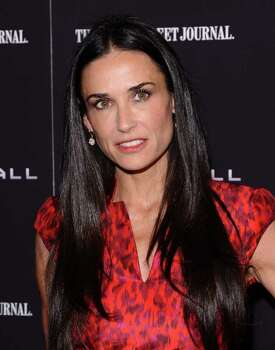 "FILE - In this Oct. 17, 2011 file photo, actress Demi Moore attends the premiere of ""Margin Call"" in New York. A spokeswoman for Moore on Tuesday, Jan. 24, 2012 said the actress is seeking professional help to treat her exhaustion and improve her health. Photo: Peter Kramer"