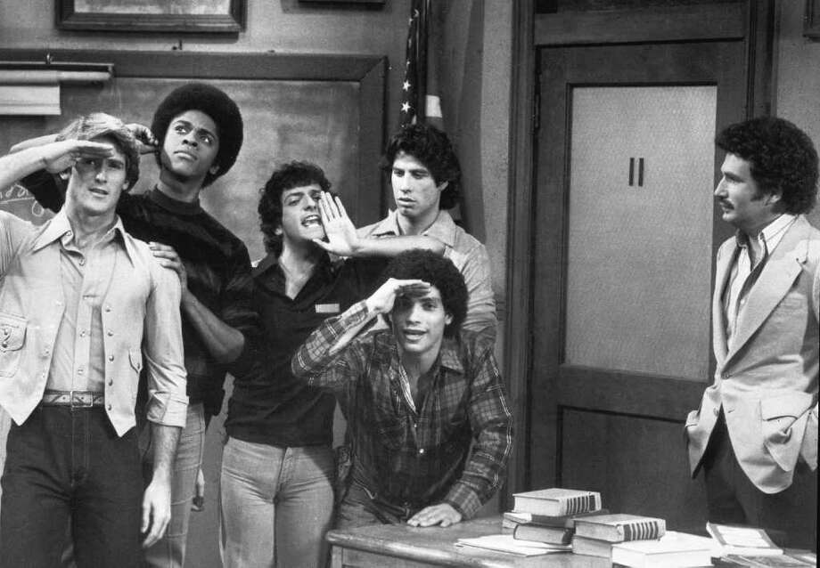 "**FILE**This file photo originally from ABC shows members of the cast of television sitcom ""Welcome Back, Kotter""  in a scene in 1978 . They are, left to right; Stephen Shortridge as Beau De Labarre, Lawrence Hilton-Jacobs as Freddy Washington, Ron Palillo as Arnold Horshack, Robert Hegyes as Juan Epstein, foreground, John Travolta,rear, as Vinnie Barbarino and Gabe Kaplan as Gabe Kotter. Dozens of old television shows including ""Welcome Back, Kotter"" will be available online and free-of-charge under a deal between America Online Inc. and Warner Bros., the companies said Monday, Nov. 14, 2005. Photo: AP / ABC"