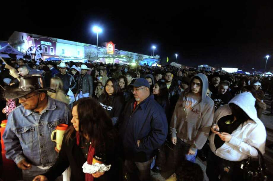 People stand in line for tacos during the annual Cowboy Breakfast at Cowboys Dance Hall on Friday, Jan. 27, 2012. Thousands of tacos, biscuits and gravy, and other foods are served to mark the beginning of rodeo season in San Antonio. Photo: Billy Calzada, San Antonio Express-News / San Antonio Express-News