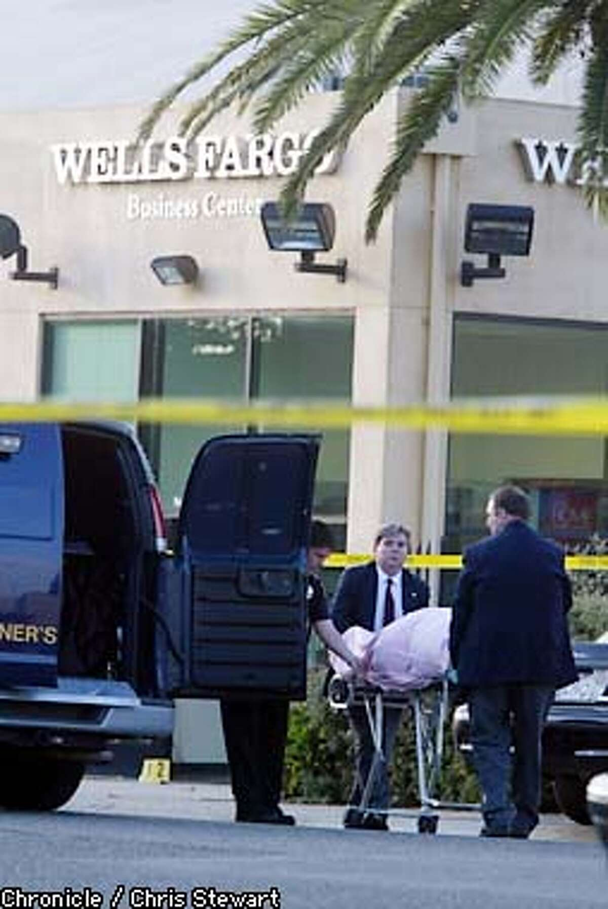 The body of a female Brinks guard is taken to a coroner's van today after gunmen attempted to rob a Brinks truck or a Wells Fargo Business Center near Ninth Street and Ashby Avenue in Berkeley, shooting two Brinks guards. One of the guards died of her wounds at the scene. The gunmen escaped in a white Ford Explorer that they abandoned in a nearby Orchard Supply parking lot. BY CHRIS STEWART/THE CHRONICLE