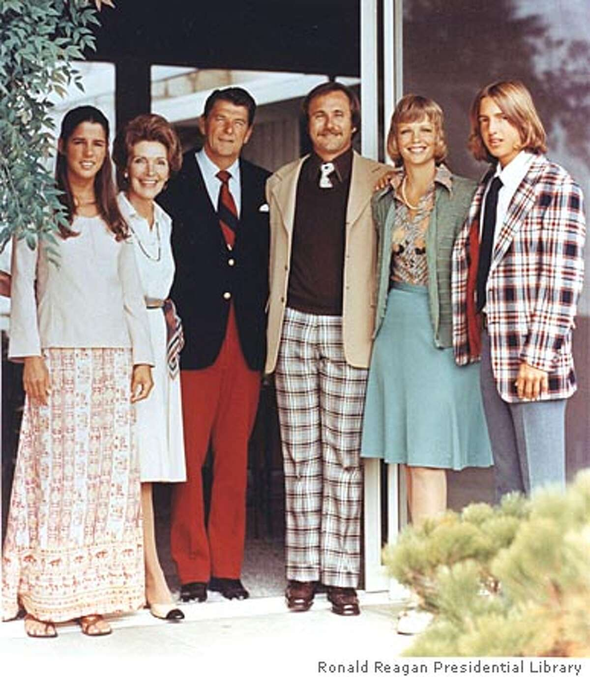 Maureen Reagan (R), the daughter of former President Ronald Reagan and actress Jane Wyman, died of cancer on August 8, 2001 in her northern California home, her family said in a statement. United States president Ronald Reagan and wife Nancy and the Reagan children are shown in this 1976 photograph outside Reagan's Pacific Palisades house. Shown (L-R) are Patti, Nancy Reagan, Ronald Reagan, Michael Reagan, Maureen Reagan and Ron Reagan. REUTERS/Reagan Family Photo Collection/Courtesy Ronald Reagan Presidential Library