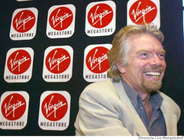 46FB0038.JPG  virgin entertainment CEO Richard branson during a press conference at the SF Virgin Megastore. He is promoting two new technologies and other store features designed to lure buyers back to the store.  Event on 12/3/03 in San Francisco.  LIZ MANGELSDORF / The Chronicle  ALSO RAN 01/17/04(3S)  also ran 01/11/2004 Richard Branson, chief executive officer of Virgin Entertainment, discusses a new approach taken at the San Francisco megastore. Richard Branson, chief executive officer of Virgin Entertainment, discusses a new approach taken at the San Francisco megastore. MANDATORY CREDIT FOR PHOTOG AND SF CHRONICLE/ -MAGS OUT Richard Branson, chief executive officer of Virgin Entertainment, is trying to make it easier for buyers to sample CDs in the store. Virgin Atlantic is seeking to lure high-end business passengers with its Upper Class suite, above, and bar, below. Richard Branson Gov. Arnold Schwarzenegger, right, is lobbying Virgin Atlantic's Richard Branson. CAT Nation#MainNews#Chronicle#12/5/2003#ALL#3star##0421513951 Photo: LIZ MANGELSDORF