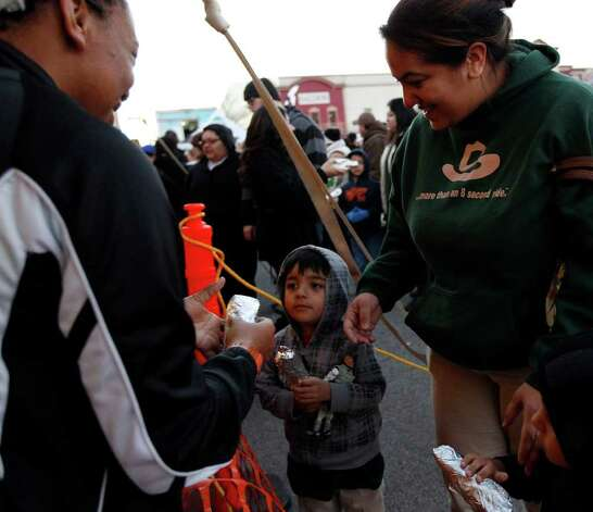 Tacos are distributed during the 34th annual Cowboy Breakfast at Cowboys Dance Hall on Friday, Jan. 27, 2012.  Photo: Michael Miller, San Antonio Express-News / San Antonio Express-News