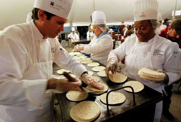 Jorge Rojo, left, and Demmer Freeman prepare tortillas during the 34th annual Cowboy Breakfast at Cowboys Dance Hall on Friday, Jan. 27, 2012.  Photo: Michael Miller, San Antonio Express-News / San Antonio Express-News