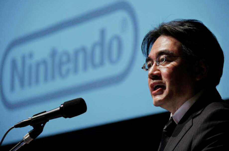 Nintendo Co. President Satoru Iwata speaks during a press conference in Tokyo Friday, Jan. 27, 2012. Nintendo, a Japanese video game machine maker, sank to losses for the April-December period, battered by a price cut for its 3DS handheld, a strong yen that erodes overseas earnings and competition from mobile devices such as the iPhone that offer games-on-the-go. (AP Photo/Koji Sasahara) Photo: Koji Sasahara / AP