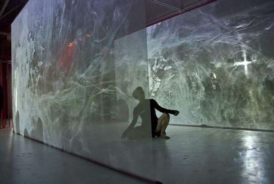What's real and what's video? It's a challenge to tell sometimes in Zoe / Juniper's fascinating performance and installation A Crack in Everything. See it with live performances at 1 p.m. each Saturday through February at DiverseWorks. Photo: Zoe/Juniper