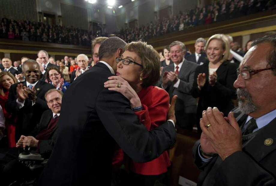 Today's letter-writers largely panned President Barack Obama's State of the Union address, but there were bipartisan smiles all around Tuesday night as the president embraced the wounded Rep. Gabrielle Giffords, D-Ariz., who was flanked by Reps. Jeff Flake, R-Ariz., (behind Obama) and Raul Grijalva, D-Ariz. (right). Photo: AP