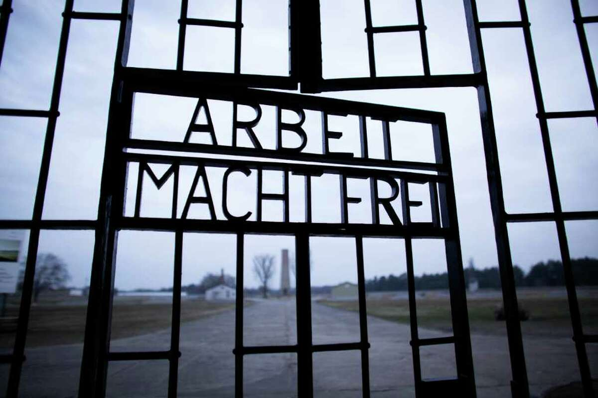 The slogan 'Arbeit Macht Frei' (Work Sets you Free) at the main entrance of the Sachsenhausen Nazi death camp on the international Holocaust remembrance day in Oranienburg, Germany, on Friday. The remembrance day marks the day of the liberation of the Auschwitz-Birkenau death camp 67-years ago.