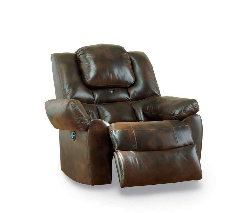 This leather power lift recliner by JCP home offers  dual massage and heat with dashboard-mount control a retractable LED reading light and hidden storage compartments in both arms, as well as a cup holder and magazine pocket, $1,150 at JCPenney. Photo: JCPenney