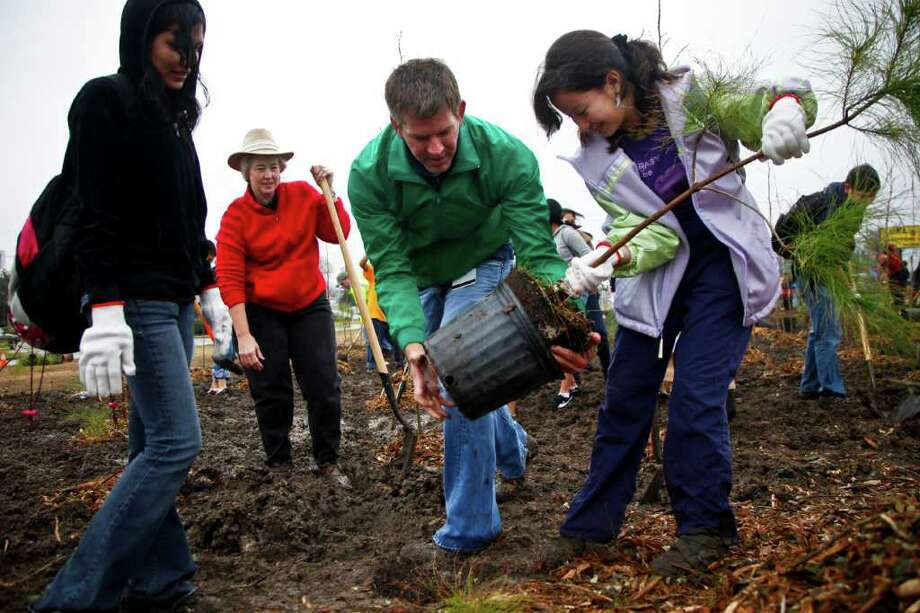 Perry also signed House Bill 419, designating the first Friday in November as Texas Arbor Day. Houston Mayor Parker held her first official Arbor Day event in 2010. Photo: Michael Paulsen / Houston Chronicle