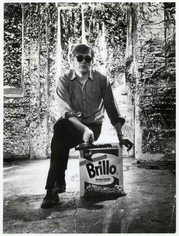 Artist Andy Warhol with one of his Brillo Box works in 1965. Photo: Photo By Billy Name