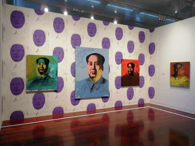 "The ""Mao"" niche -- complete with Mao wallpaper -- is one of the most striking areas of ""Andy Warhol: Fame and Misfortune"" at the McNay Art Museum. Photo: Photo By Steve Bennett"