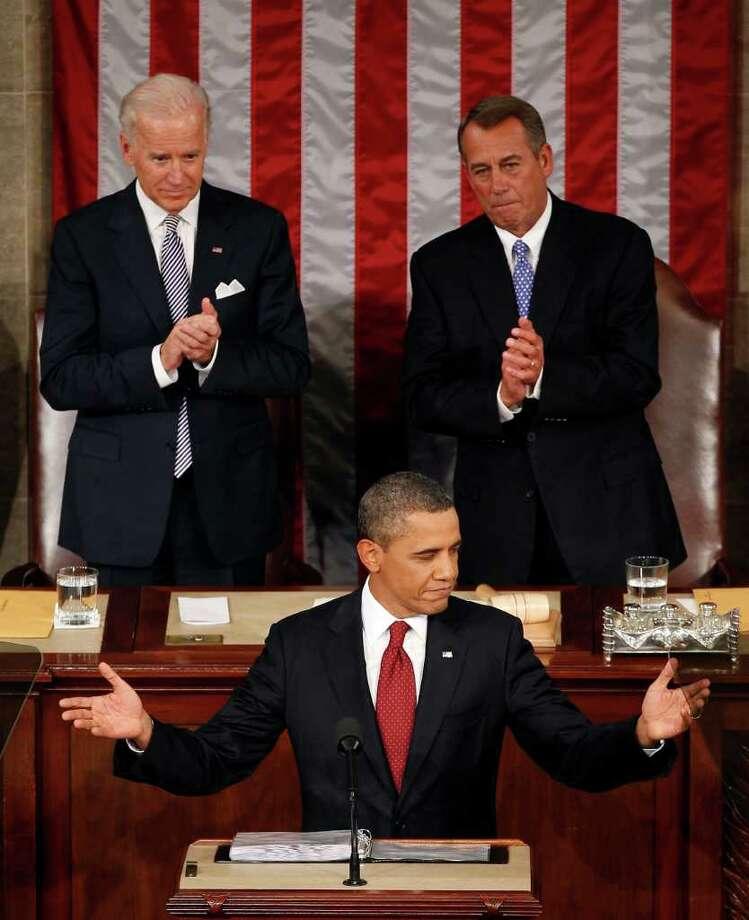 El presidente Barack Obama, en su mensaje sobre el Estado de la Unión, flanqueado por el vicepresidente Joe Biden (izq.) y el presidente de la Cámara Baja, John Boehner (der.). Photo: J. Scott Applewhite / AP