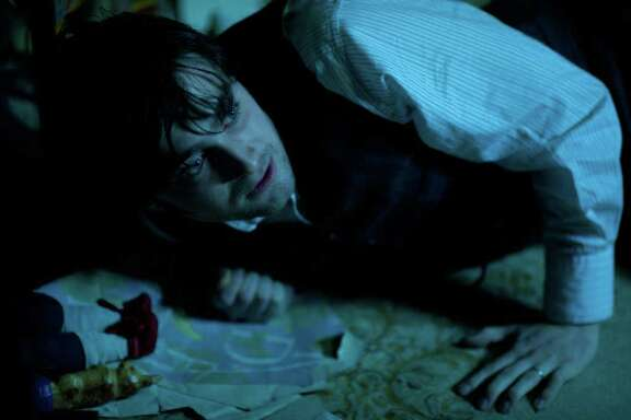 """Daniel Radcliffe stars in """"The Woman in Black"""", a ghost story in which he plays a lawyer sent to settle the estate of a client."""
