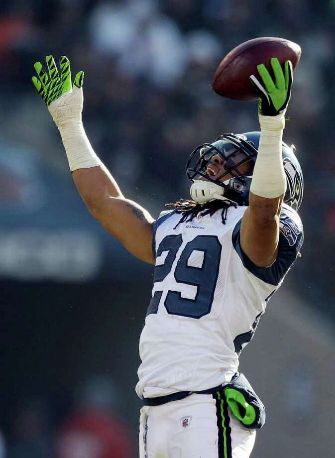 Seattle Seahawks safety Earl Thomas (29) reacts after recovering a fumble by Chicago Bears wide receiver Johnny Knox (13) in the first half of an NFL football game in Chicago, Sunday, Dec. 18, 2011. Knox was injured on the play. (AP Photo/Nam Y. Huh) Photo: (AP Photo/Nam Y. Huh), STF / AP