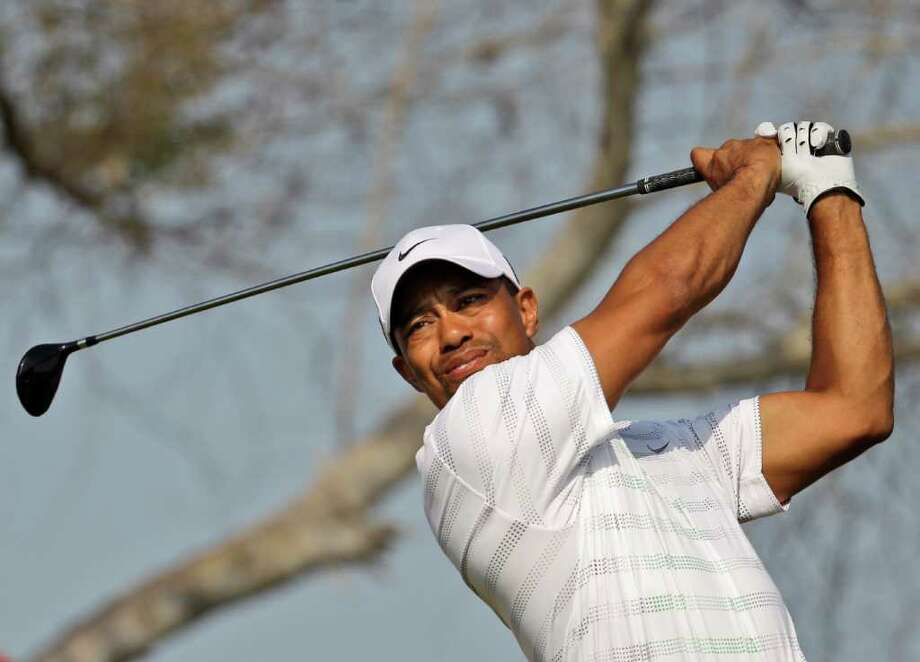 Tiger Woods from U.S. tees off on the 11th hole during the second round of Abu Dhabi HSBC Championship, Friday, Jan. 27, 2012 in Abu Dhabi, United Arab Emirates. Photo: Kamran Jebreili, AP / AP