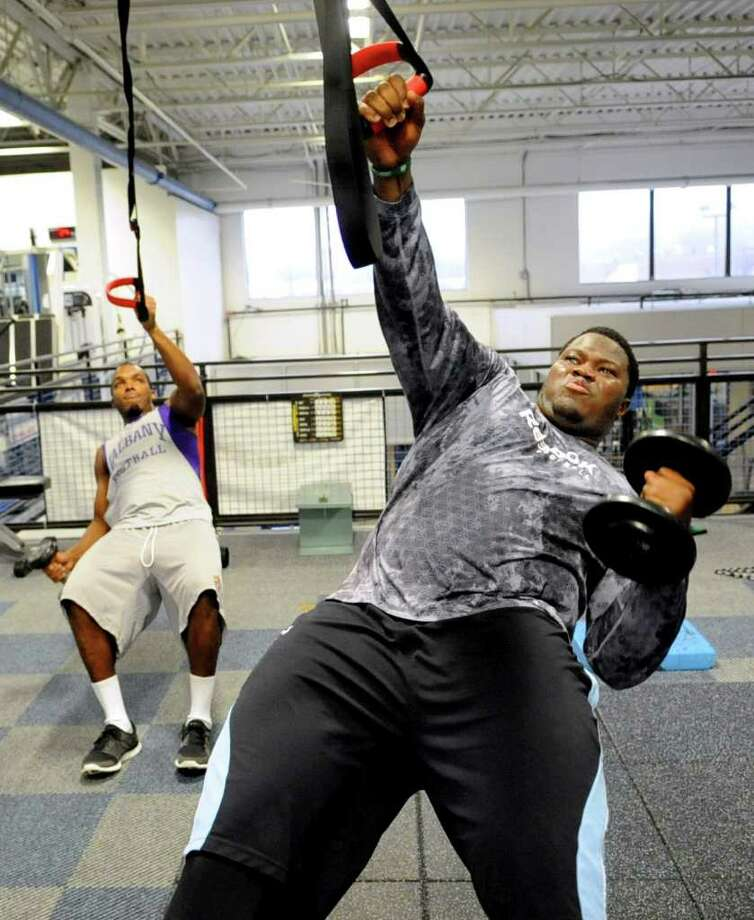 New York Jet Vlad Ducasse, front, works out with former Stamford teammates, including Ross Bertrand, back, at BlueStreak Sports Training in Stamford on Friday, January 27, 2012. Photo: Lindsay Niegelberg / Stamford Advocate