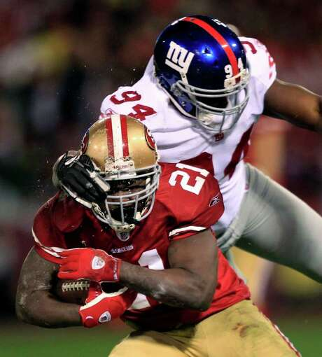 San Francisco 49ers' Frank Gore (21) is tackled by New York Giants' Mathias Kiwanuka (94) during the second half of the NFC Championship NFL football game Sunday, Jan. 22, 2012, in San Francisco. Photo: AP