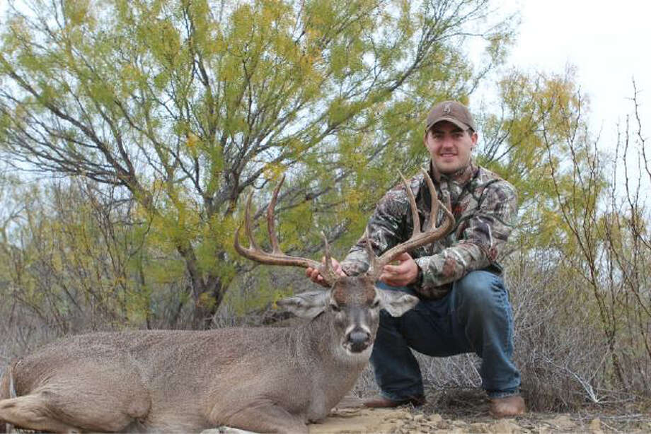 Stephen McGee with a deer he killed in 2012 during the NFL off-season. Picture is from his Twitter account. Photo: Stephen Mcgee Twitter