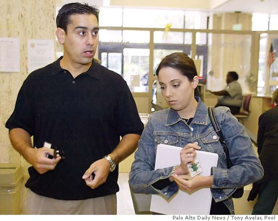 Brent Rocha, left, brother of Laci Peterson, and Amy Rocha, sister of Laci Peterson, arrives for the Scott Peterson trial in Redwood City, Calif., Thursday, June 3, 2004. Peterson is the Modesto, Calif., man who could face the death penalty if he's convicted of two counts of murder for the deaths of his wife, Laci Peterson, and their unborn child. (AP/Palo Alto Daily News / Tony Avelar, Pool)