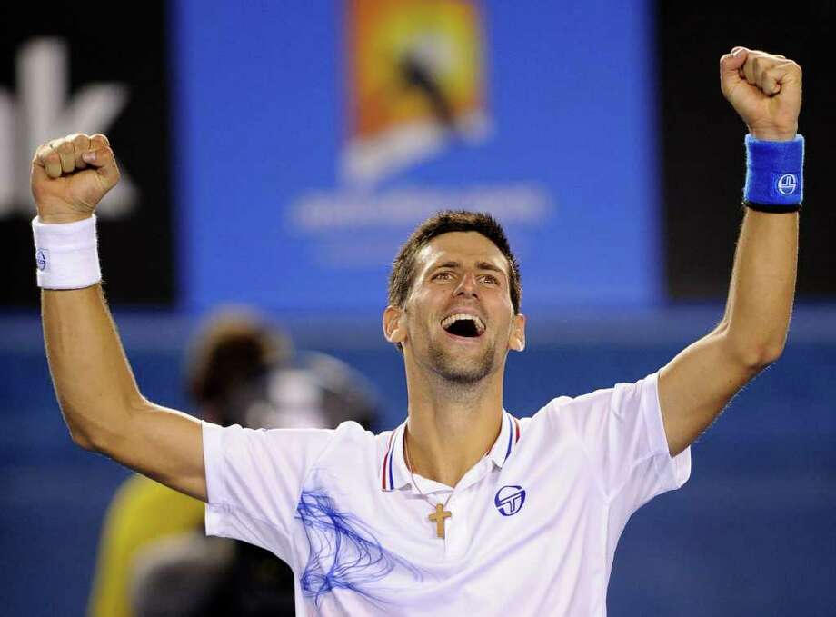 Novak Djokovic of Serbia celebrates after defeating Andy Murray of Britain during their semifinal at the Australian Open tennis championship, in Melbourne, Australia, early Saturday, Jan. 28, 2012. Photo: AP