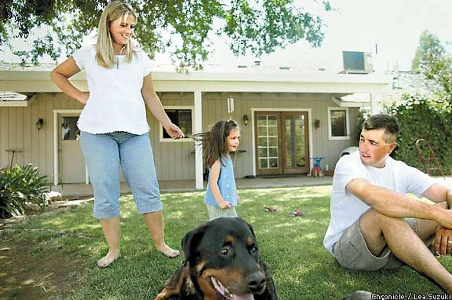 Jennifer and Will Breckenridge hang out in their Madera backyard with daughter Rilee, 2 1/2, and dog Rastus. Chronicle photo by Lea Suzuki