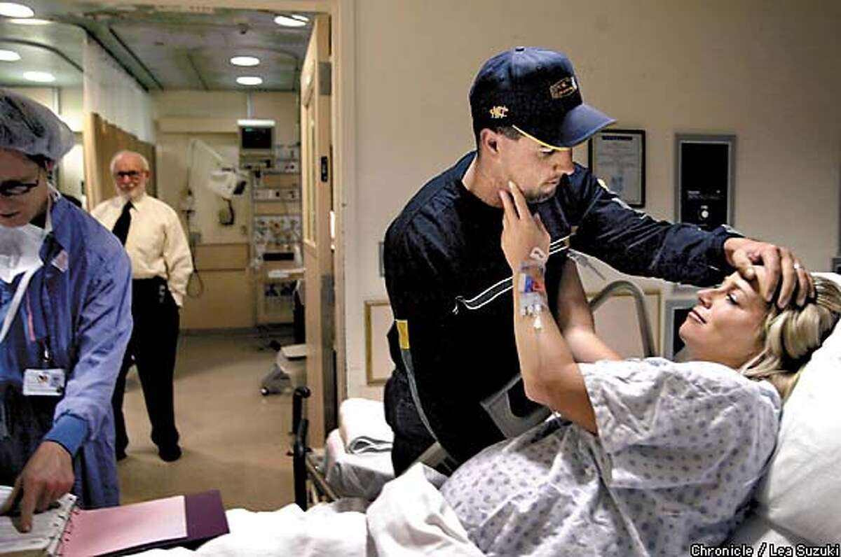 Will Breckenridge comforts his wife, Jennifer, before she is taken into the pediatric operating room for fetal surgery at UCSF. Their fetus has congenital diaphragmatic hernia. Chronicle photo by Lea Suzuki
