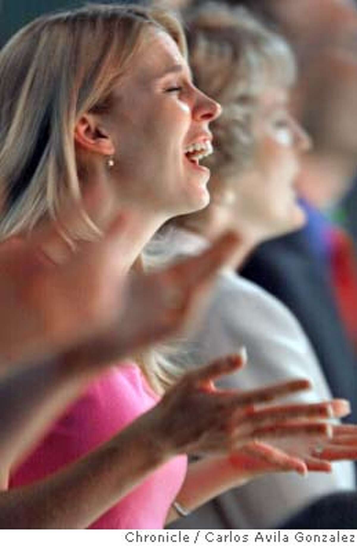A congregant sings along during the International Church of the Foursquare Gospel's Annual Convention at the San Francsico Hilton in San Francisco, Ca., on Tuesday, June 1, 2004. Photo taken on 06/01/04 in San Francisco, Ca. Photo By Carlos Avila Gonzalez / The San Francisco Chronicle