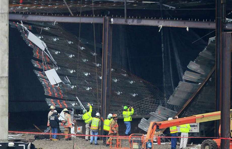 Workers and officials inspect a construction collapse Friday at the Horseshoe Casino in Cincinnati. Photo: Al Behrman / AP